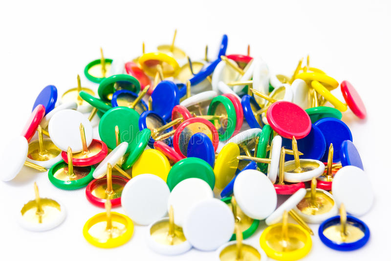 Colorful tacks on white background isolated stock photography