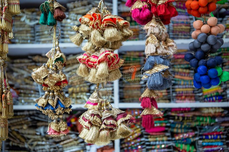 Colorful tailor supplies like ribbons and embroidery material in a street shop in the tailor market in Mumbai, India.  royalty free stock photo