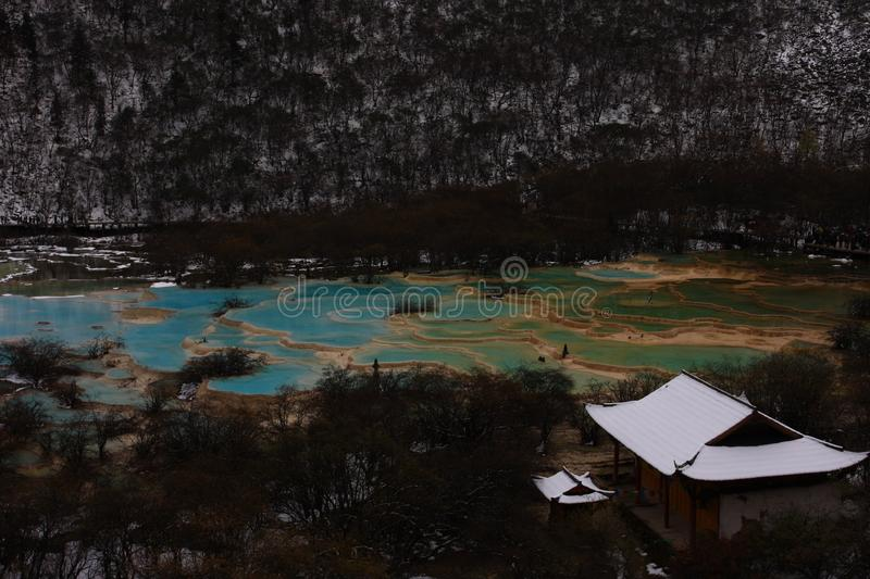 Colorful talpatate ponds after the first snow stock images