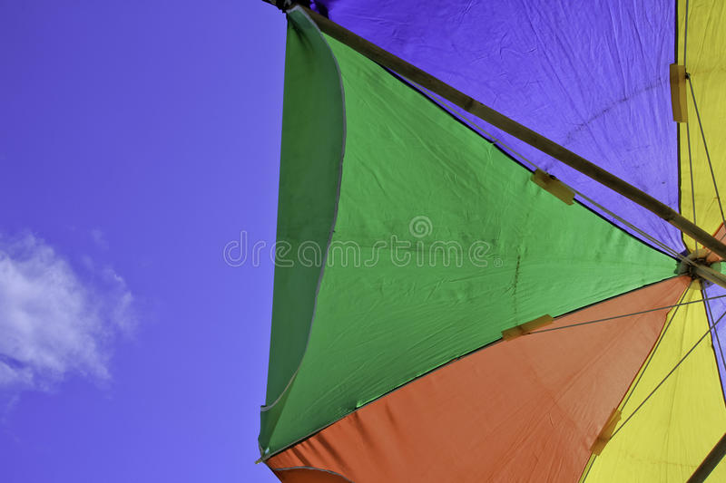 Colorful tent and blue sky. Enjoying a sunny day under a tent colored royalty free stock photography