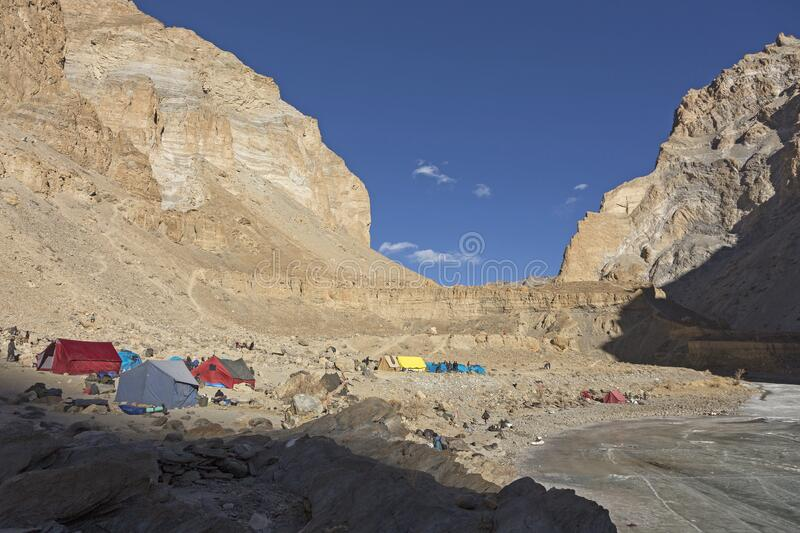 Colorful tents on the frozen Zanskar river Chadar trek. Active adventure travel concept image. The only place to camp on the Zanskar trek is by the side of the stock images