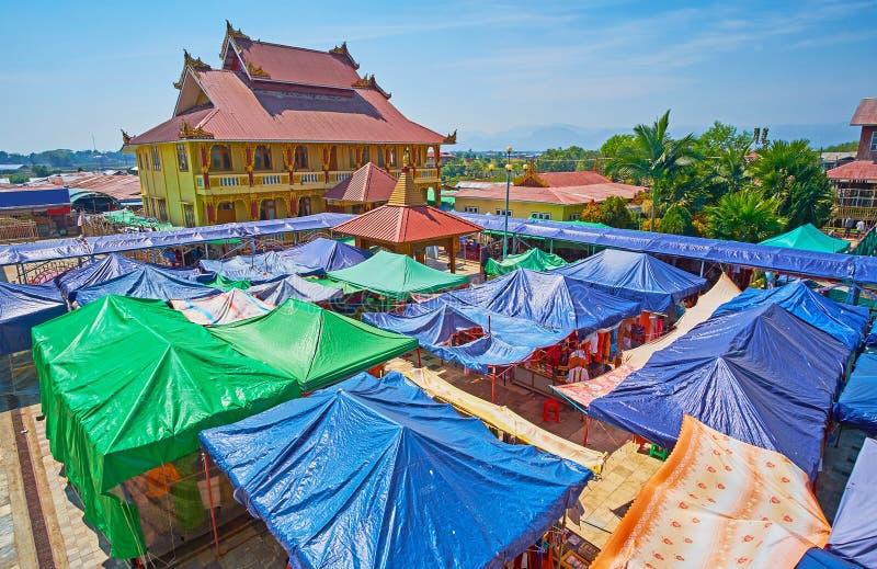 The tourist market of Ywama, Inle Lake, Myanmar. The colorful tents of the large tourist market, located around the main shrine of Hpaung Daw U Pagoda and stock photos
