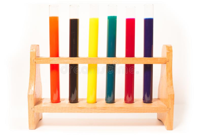 Colorful test tubes filled with fluids. Many test tubes filled with fluids of various colors royalty free stock photo