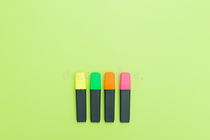 Colorful text markers on greenbackground. Copy space. Flatlay. stock photography