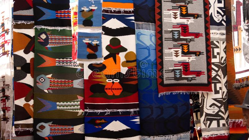 Hanging textiles. Colorful textiles hanging in the Artisan`s Market in Otavalo, Ecuador royalty free stock photo