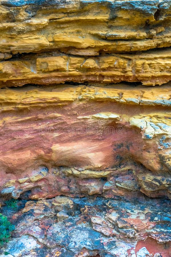 Colorful texture of a rocky sediment with different colors royalty free stock photography
