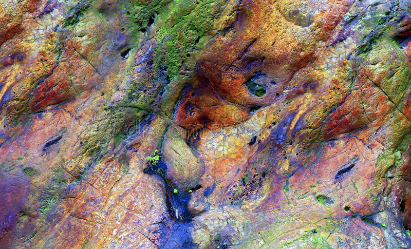 Colorful textured rock background stock image