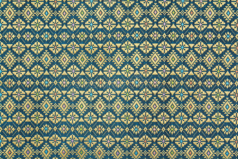 Colorful thai silk handcraft peruvian style rug surface close up royalty free stock photos