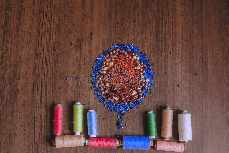 Colorful thread and bead stock images