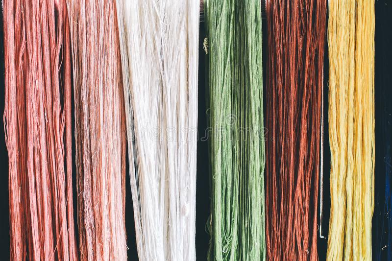 Colorful thread raw silk cloth dye from natural color material for woven, handicraft thai royalty free stock photos