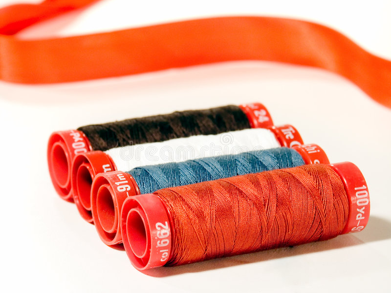 Colorful threads. A set of colored threads on spools royalty free stock photos