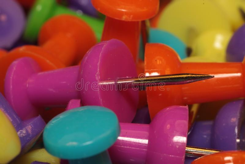 A colorful thumb tack stock image