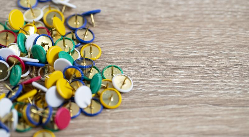 Colorful thumb tacks on the table stock images