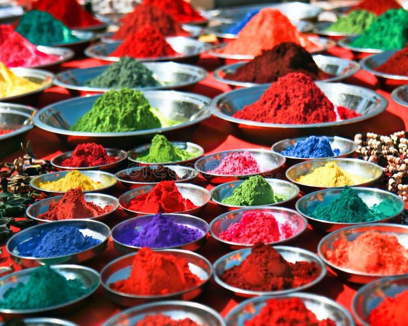 Colorful tika powders on indian market, India stock photography