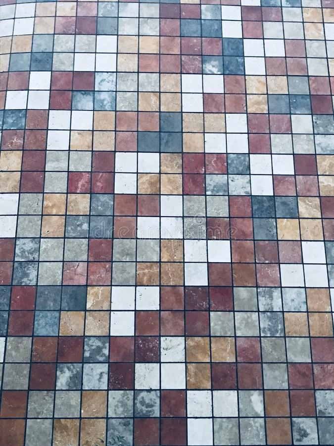 Colorful tiles texture. Colored cubed tiles in red white grey brown and yellow royalty free stock photos