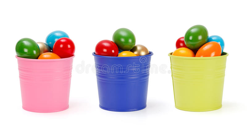 Colorful tin pails with Easter eggs royalty free stock photo