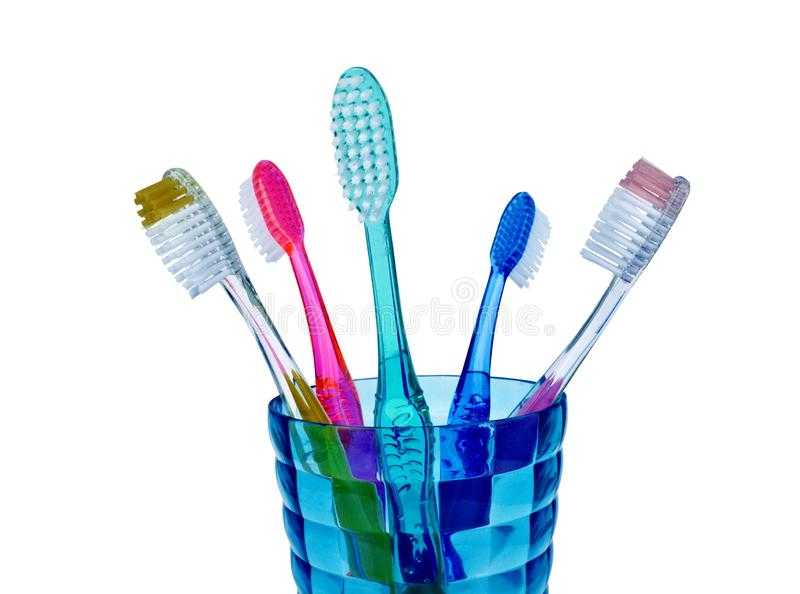 Colorful toothbrushes isolated on white stock images