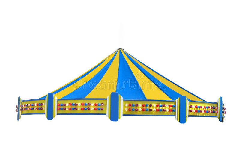 Colorful top of a carousel ride isolated. Colorful tent top of a carousel ride with yellow and blue panels, with a boarder of multi-colored lights. Isolated on stock image