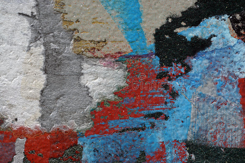 Colorful torn old posters as abstract colorful textured backgro. Colorful torn/ripped old posters on grunge old metal surface Creative abstract textured stock images