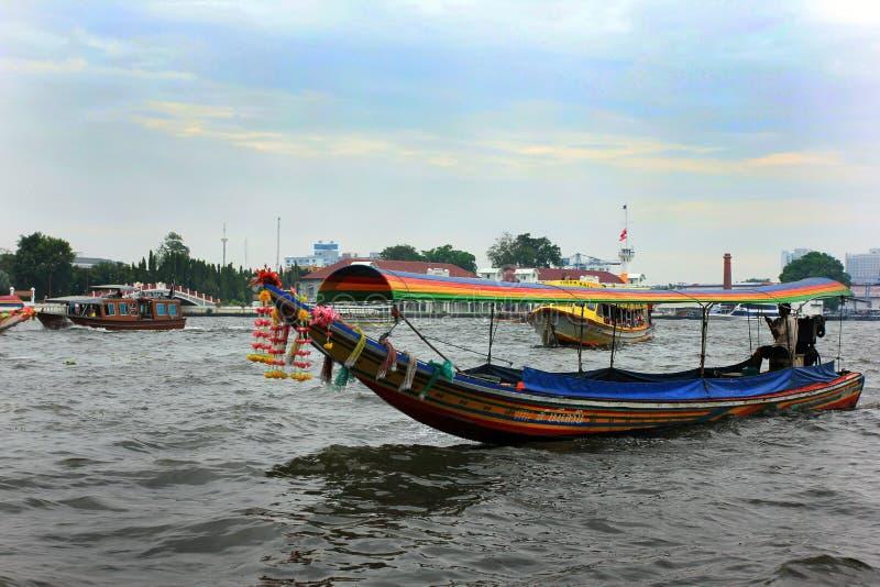 Colorful tourist boats in Bangkok, Thailand stock photo