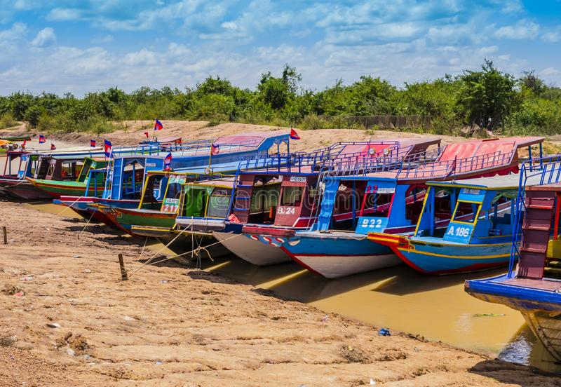 Boats moored on river bank to explore Tonle Sap lake, Siem Reap Province, Cambodia royalty free stock images