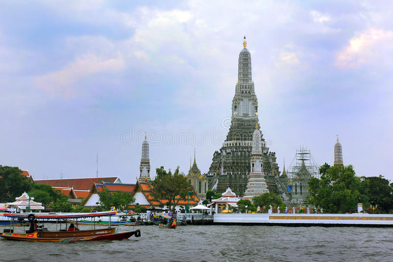 Colorful tourist boats and Wat Arun temple in Bangkok, Thailand royalty free stock photos