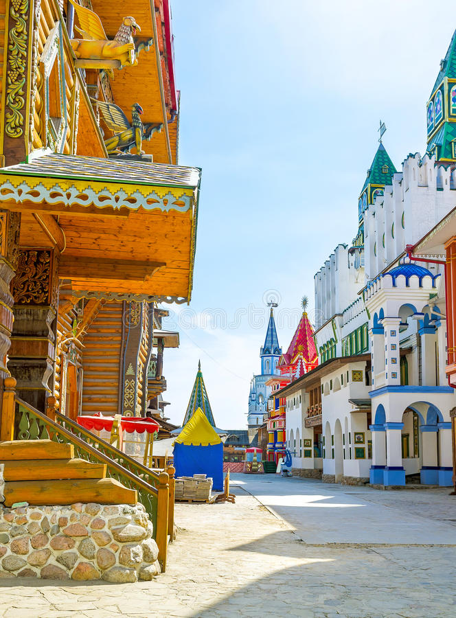 The colorful towers. The colorful mansions, wooden carved palaces and churches, old-styled sculptures and patterns, towers and weathervanes give to Izmailovsky royalty free stock image
