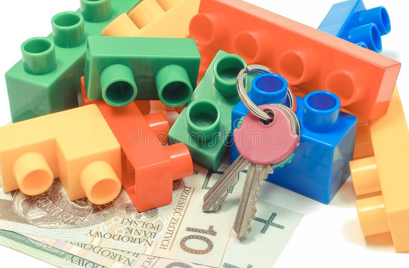 Colorful toy blocks, home keys and money. Building house concept. Plastic colorful toy blocks, home keys and polish currency money. Building house concept royalty free stock images