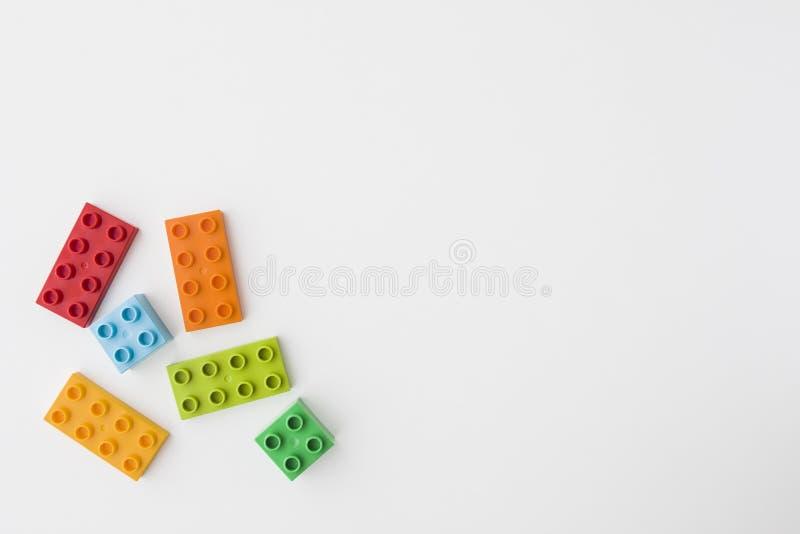Colorful toy bricks on white background stock photos