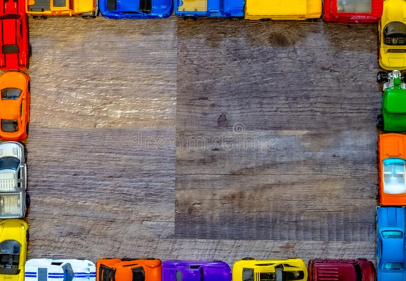 Toy cars framing a wooded surface royalty free stock image