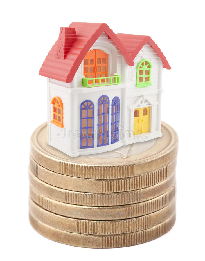 Colorful Toy House On Stack Of Euro Coins Stock Images