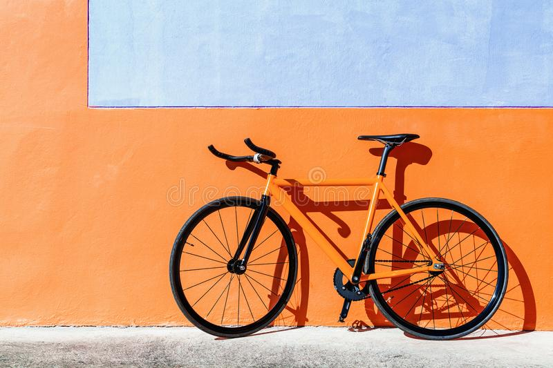 Orange fixed gear bicycle royalty free stock photography