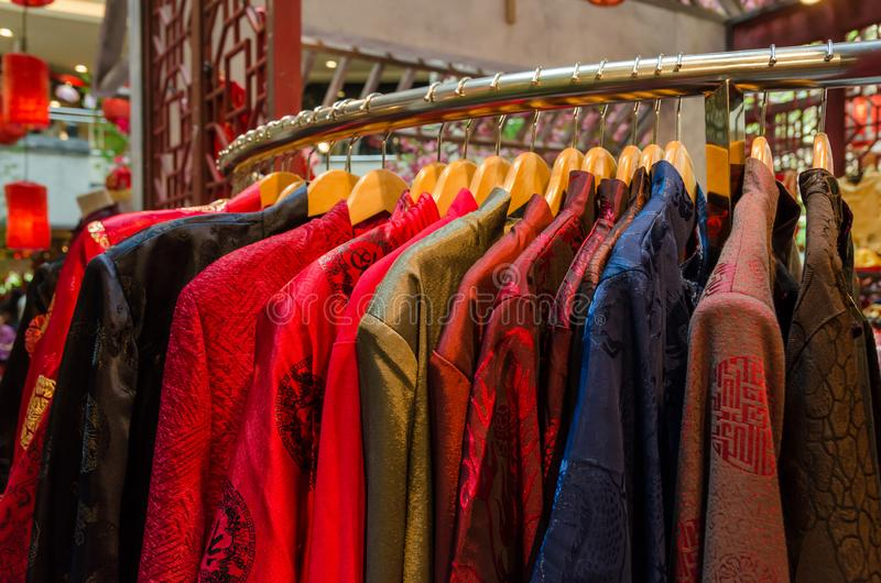 Colorful traditional chinese costumes hanging for sale royalty free stock images