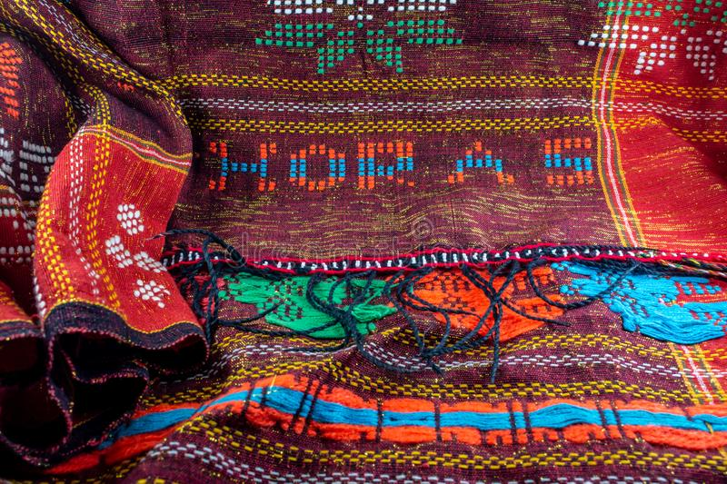 colorful traditional fabric from indonesia. Horas words or texts mean greetings in Batak language. textile industry stock photography
