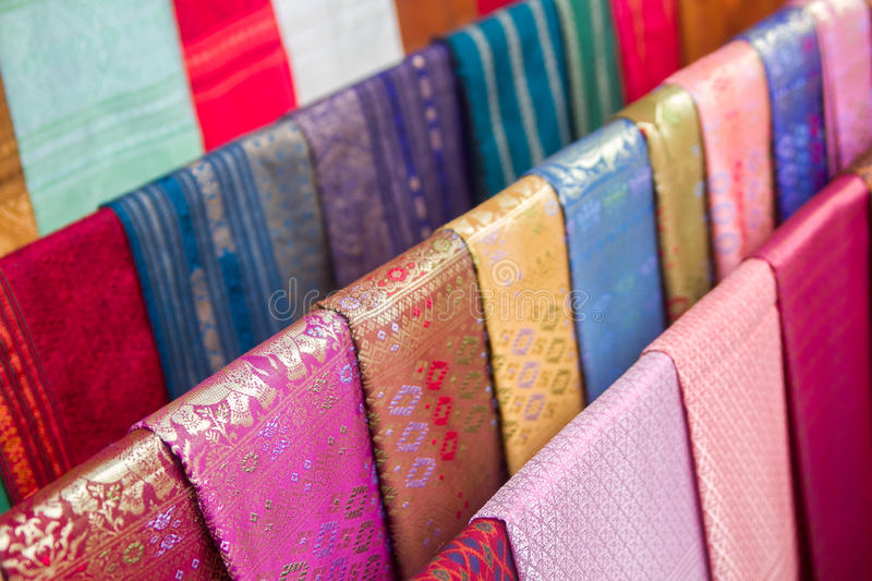 Colorful traditional Lao silk textiles, Luang Prabang, Laos.  royalty free stock images