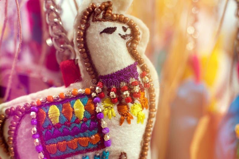 Colorful traditional little wool Llama doll handmade stock photo