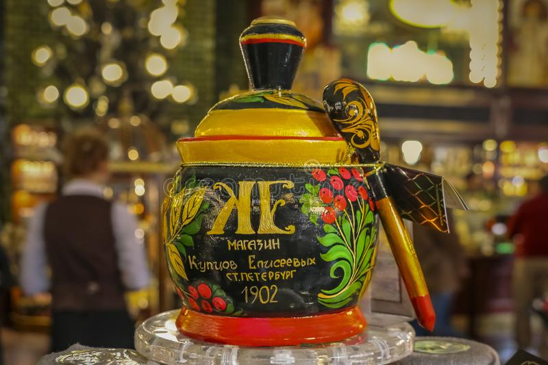 Colorful traditional Russian Hohloma or Khokhloma laquer jar and spoon at the Eliseevsky store, Saint Petersburg, Russia royalty free stock photography