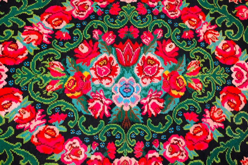 Colorful traditional vintage handmade folk carpet with floral shapes and motifs of Moldovian or Romanian traditions. royalty free stock image