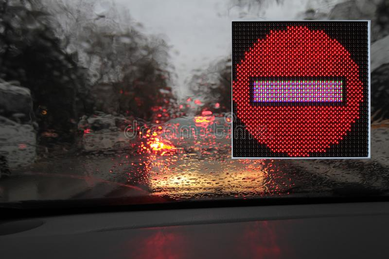 Colorful traffic warning and guidance signs made with LED lights stock image