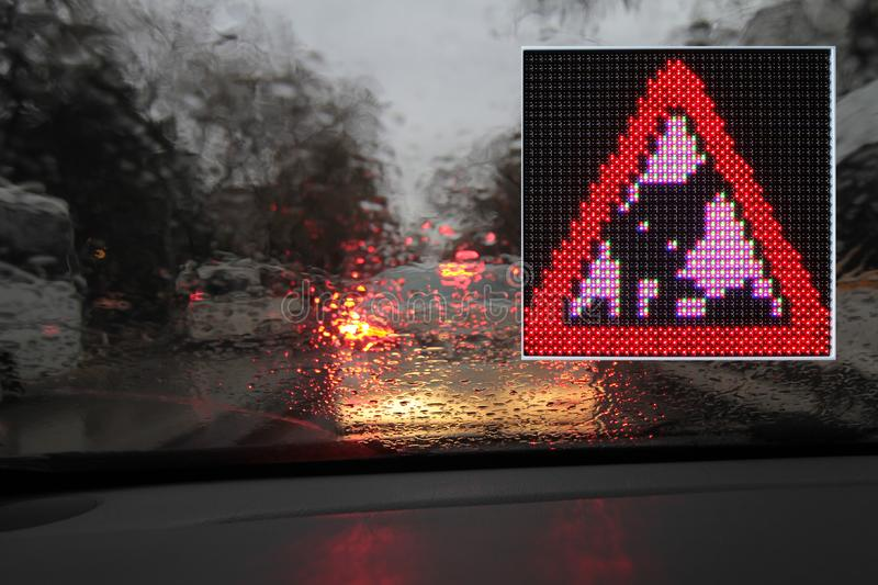 Colorful traffic warning and guidance signs made with LED lights. One way, don`t turn u, don`t turn left, don`t turn right stock image