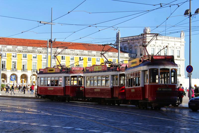 Colorful trams through the streets of Lisbon in Autumn stock photography