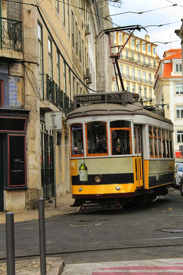 Colorful trams through the streets of Lisbon in Autumn. royalty free stock photos