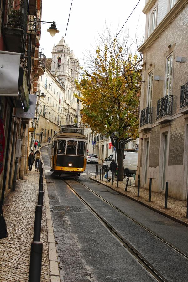 Colorful trams through the streets of Lisbon in Autumn royalty free stock images