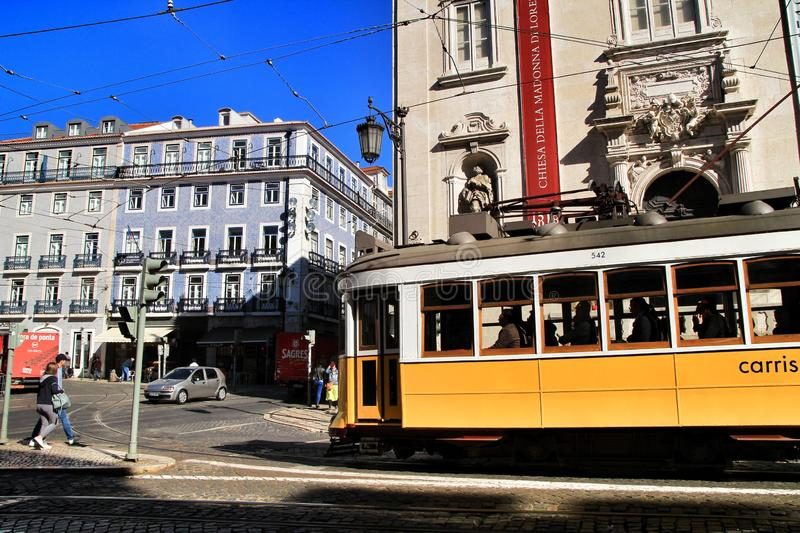Colorful trams through the streets of Lisbon in Spring royalty free stock photo