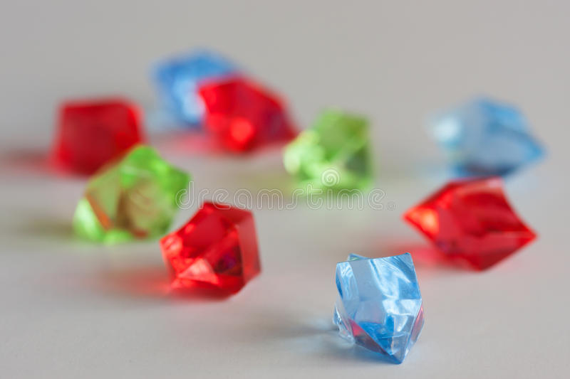 Colorful transparent chrystals. Blurred colorful chrystals on light background - focus on blue stock photos