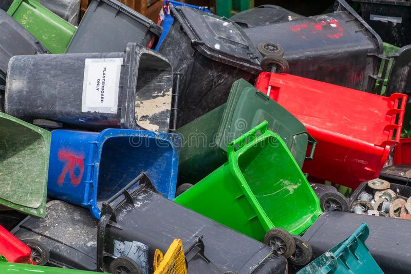 Colorful trash cans. Many plastic garbage cans on the waste waiting to be recycled royalty free stock photography