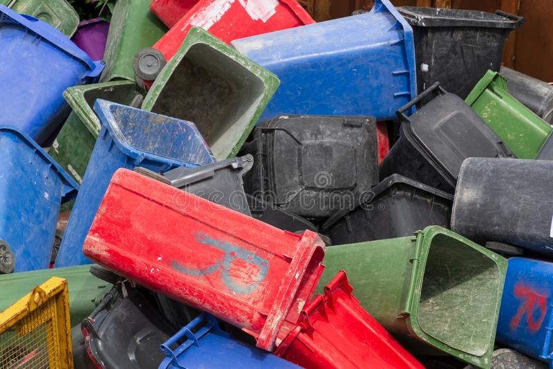 Colorful trash cans. Many plastic garbage cans on the waste waiting to be recycled royalty free stock photo