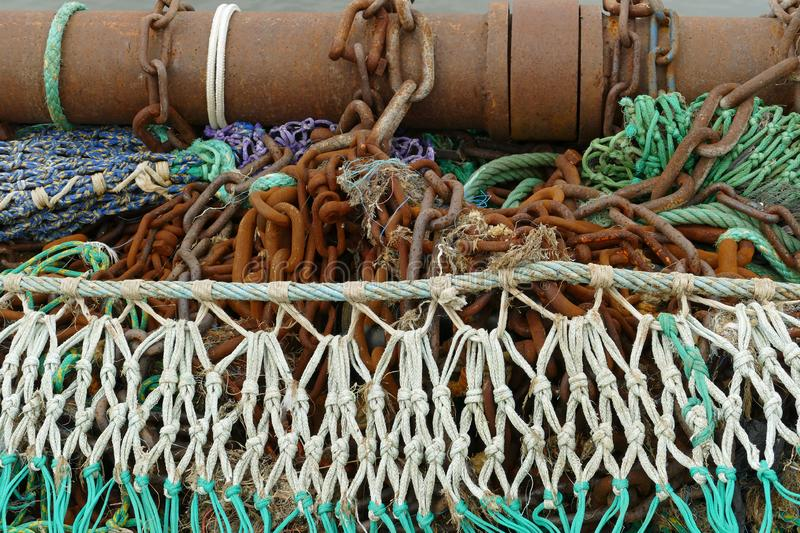 Colorful trawl with rusty drawing equipment royalty free stock photo