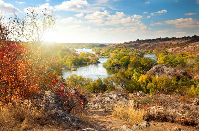 Colorful Trees and River - beautiful sunny autumn season. Colorful Trees and River - beautiful sunny autumn day, panoramic scene of fall season stock photo