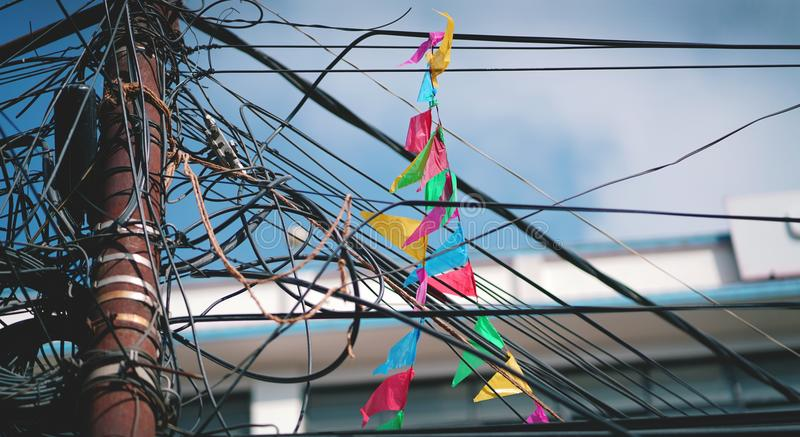 Colorful Triangle Flag On Electrical Wire Cable Tangled And Chao ...
